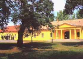 "Arany János Museum with the monument ""Grand School Staff"""