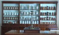 The inlaid furniture, scales and dishes of the pharmacy