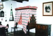 Dwelling room with towered bed