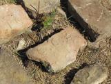 A kemencét borító omladékban számos évszámos téglát találtunk, melyeken az 1819-es évszám, valamint a CCZ monogram díszlik.