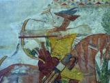 Két tartalék nyílvessző a kun harcos kezében a kakaslomnici templom freskóján